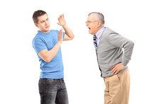 Mature Man Yelling At A Young ...