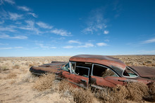 Old Rusted Car In The Middle O...