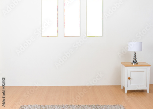 Empty Interior With Blank Photo Frames And Decorate Lamp