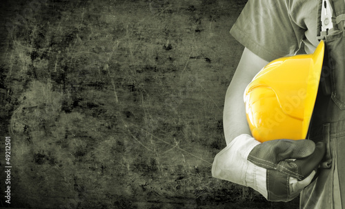 Fotografia  Worker and grunge texture in background
