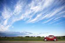 Red Volkswagen Beetle Car On R...