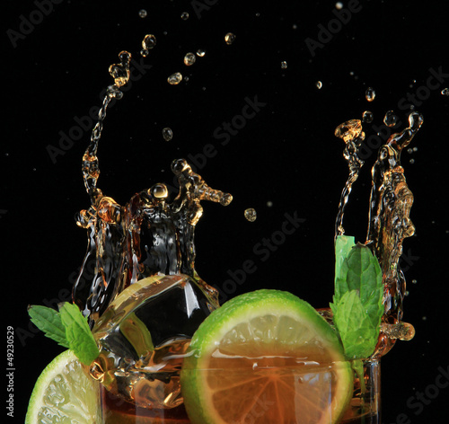 Recess Fitting Splashing water Cuba libre cocktail on black background