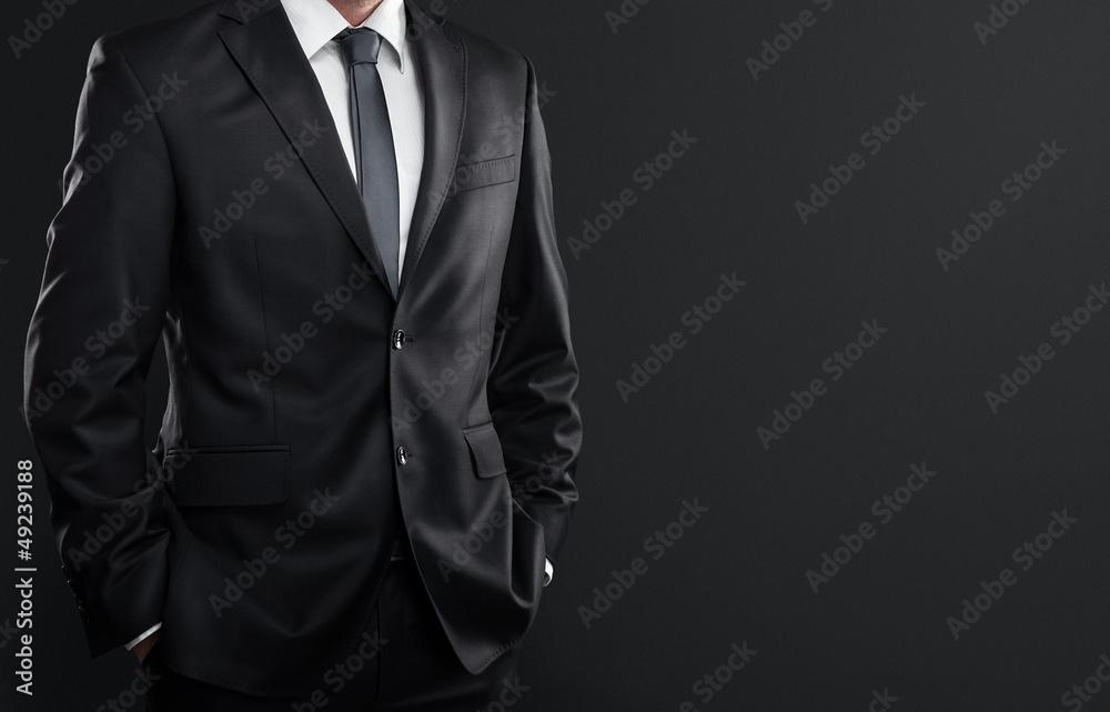 Fototapeta Close up of businessman over dark gray background