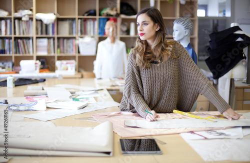 Fotografija  Fashion designer daydreaming in the studio