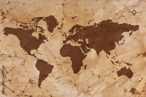 Photo sur Aluminium Carte du monde Old World map on creased and stained parchment paper