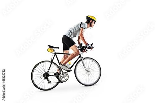 Fotografie, Obraz  Male bicyclist riding a bike