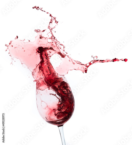 red wine splashing out of a glass, isolated on white Fototapete