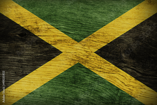 JAMAICAN FLAG ON WOOD Canvas Print