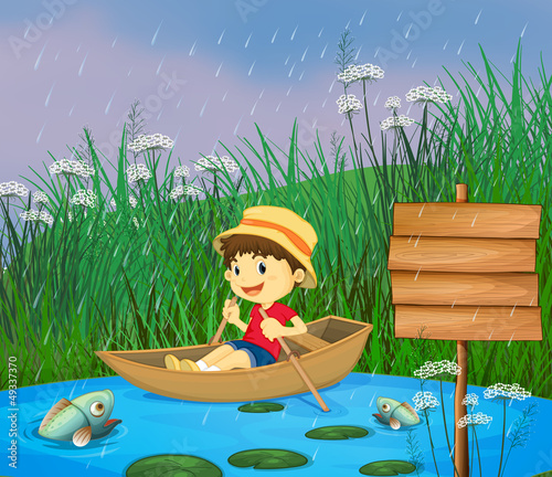 Canvas Prints River, lake A river and a smiling boy in a boat