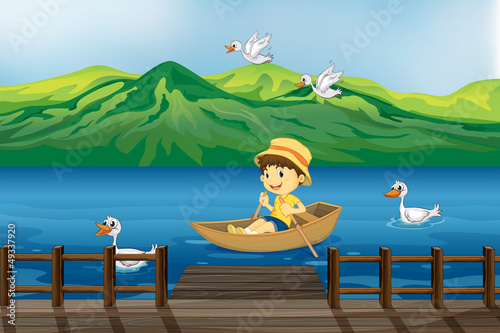 Wall Murals Birds, bees A boy riding on a wooden boat
