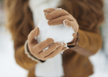 Closeup On Snow Ball In Woman Hand