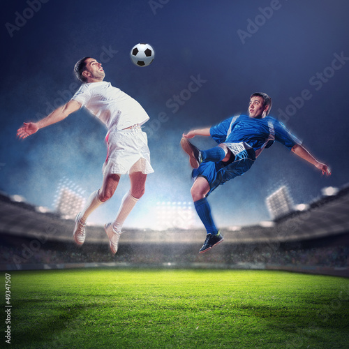 Staande foto Voetbal two football players striking the ball