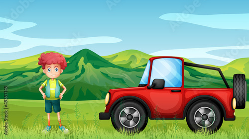 Photo sur Toile Voitures enfants A red jeepney and a boy in the hills