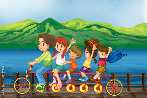 Canvas Prints River, lake Kids biking at the bridge