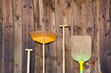Farmers Tools On Old Barn Wall Background