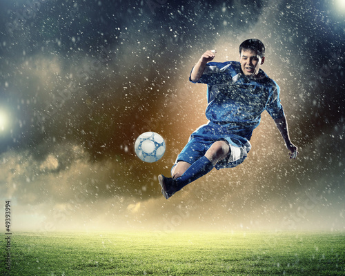 Photo Stands Football football player striking the ball