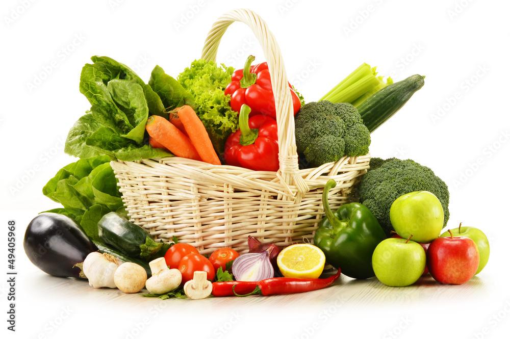 Fototapeta raw vegetables in wicker basket isolated on white