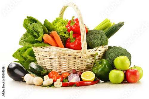 Fotobehang Groenten raw vegetables in wicker basket isolated on white