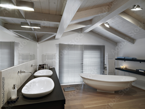 Bagno moderno con parquet in mansarda buy this stock photo and