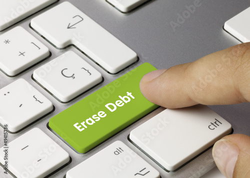 Fotografía  Erase Debt keyboard key. Finger