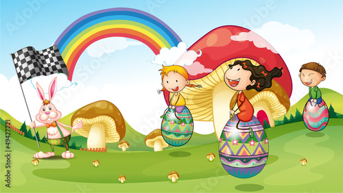 In de dag Regenboog A bunny and kids with easter eggs