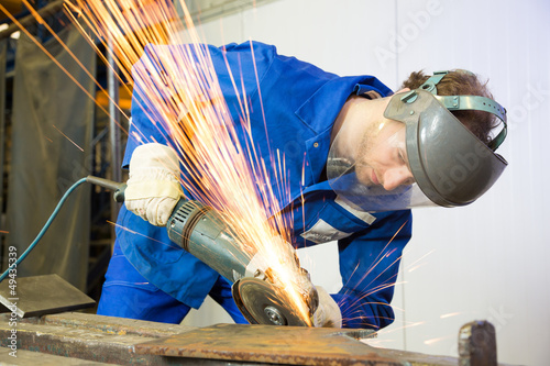 Construction worker with angle grinder Fotobehang