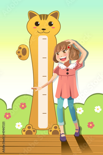 Tuinposter Hoogte schaal Girl measuring her height