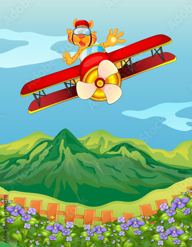 A tiger riding in an airplane