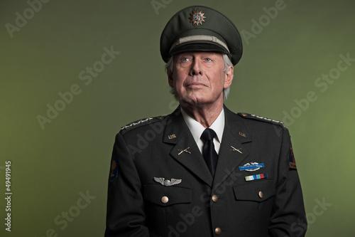 Leinwand Poster Military general in uniform. Studio portrait.