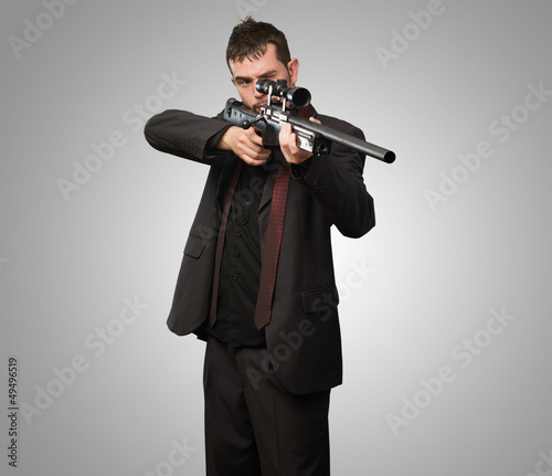 Young Man Aiming With Rifle Wallpaper Mural