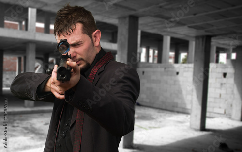 Photo  Man aiming with rifle
