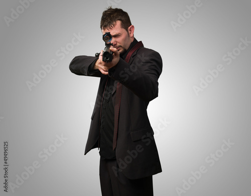 Man aiming with rifle Canvas Print