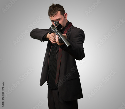 Man in suit pointing with a rifle Wallpaper Mural