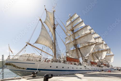 Fotobehang Art Studio Tall Ship Moored at Full Sail