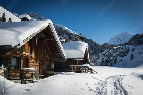 wooden houses on austrian mountains at winter with a lot of snow #49529107