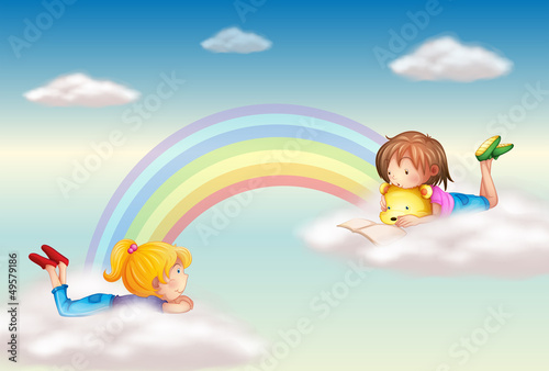In de dag Regenboog Two girls along the rainbow