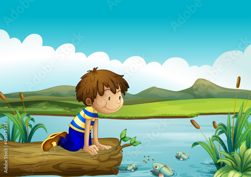 Canvas Prints River, lake A young boy watching the fishes