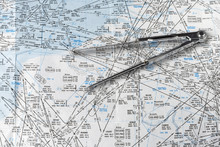A Pair Of Compasses On An Aeronautical Navigational Chart