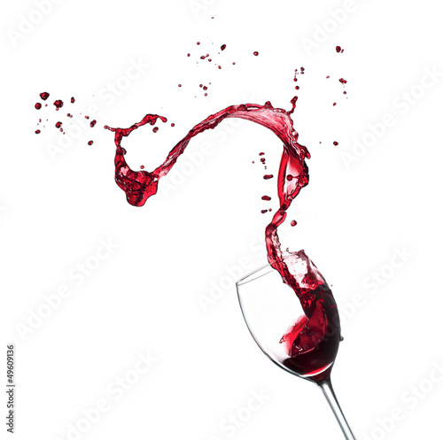Stampa su Tela Red wine splashing from glass, isolated on white background