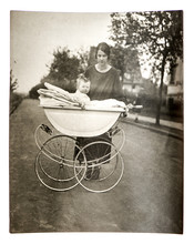 Mother With Baby In Vintage Buggy