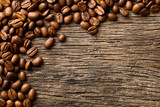 coffee beans on vintage wooden background