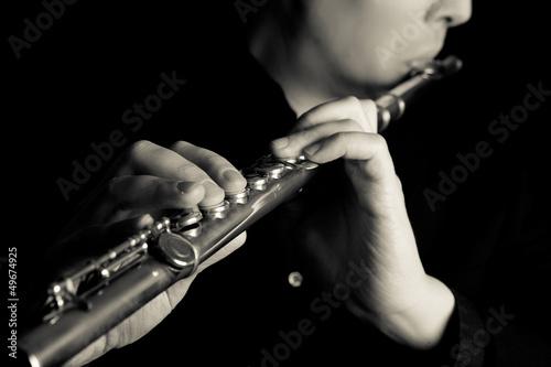 Fotografia, Obraz professional flutist musician playing flute on black background
