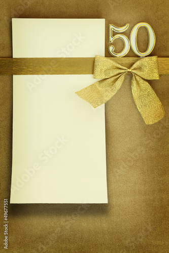 Photographie  Anniversary card on golden background