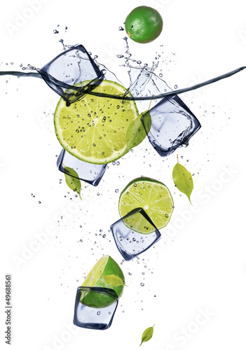 Fotobehang In het ijs Limes with ice cubes, isolated on white background