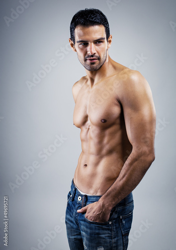 Deurstickers Akt A handsome male model posing at a studio.