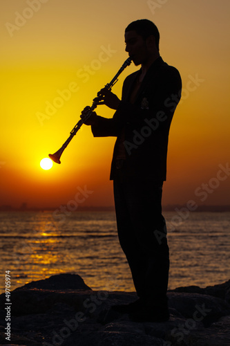 Stampa su Tela Clarinet at sunset
