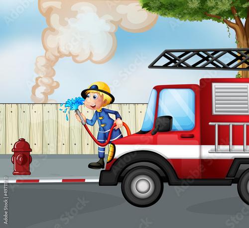 Keuken foto achterwand Cars A fireman rescuing a fire near the street