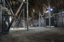 Old Wooden Barn With Light Shi...