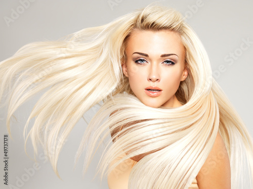 Fotografie, Obraz  Blond woman with long straight hair