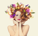 Beautiful redhead girl with flowers isolated.